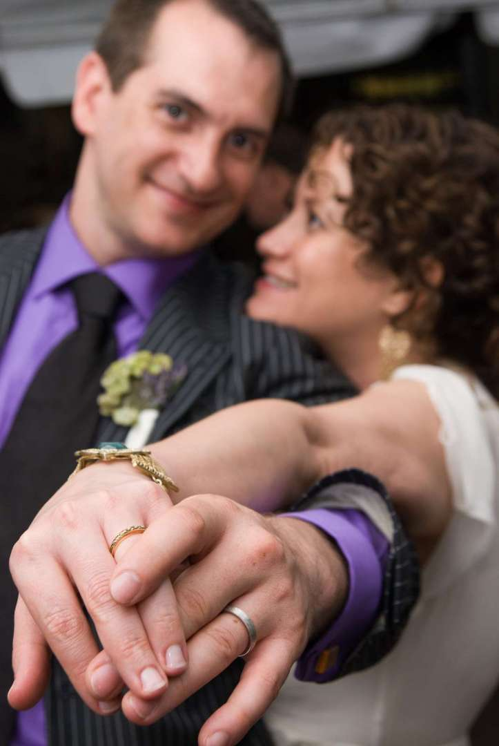newlyweds showing their wedding rings.jpg