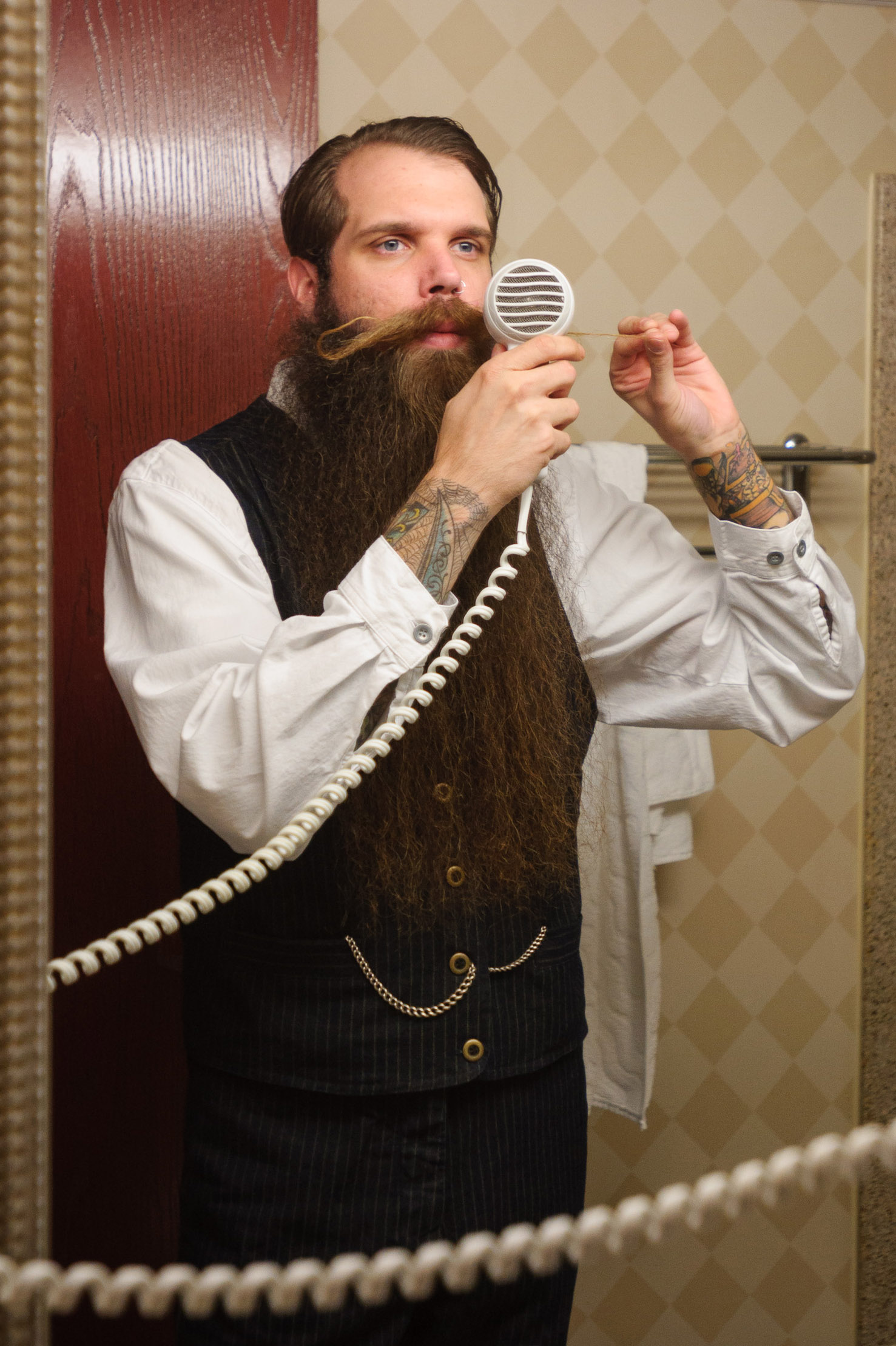 groom grooms moustache in mirror