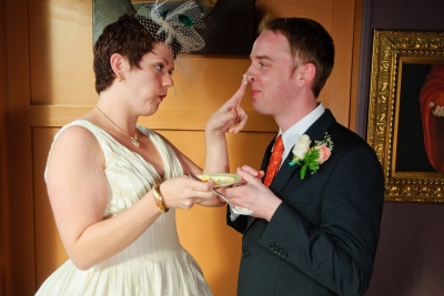 bride puts cake on grooms nose.jpg
