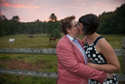 women kissing in a rural setting