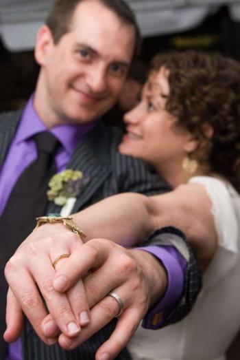 newlyweds showing their wedding rings.jpg