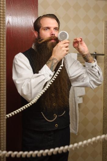 groom grooms moustache in mirror