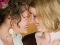 two women smiling, touching foreheads, best of