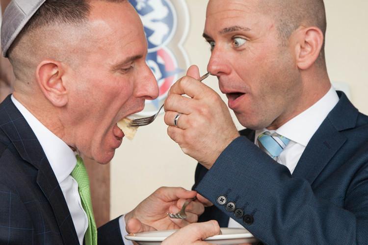 fun wedding couple eating