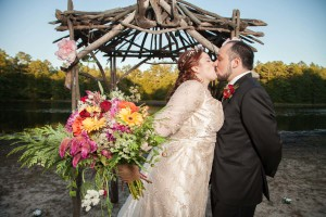 bride and groom kissing with bouquet