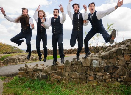 groom and best men jumping. Why Hire a Professional Wedding Photographer
